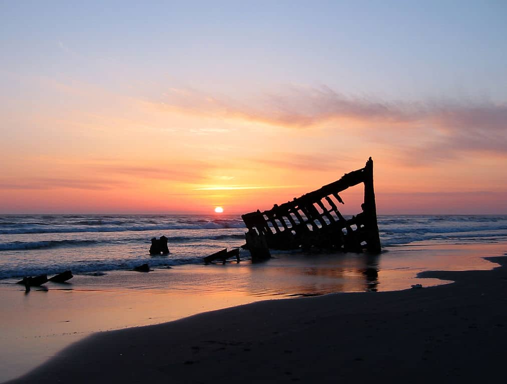 The wreck of the Peter Iredale in the Fort Stevens State Park, Oregon, USA, at sunset. Ran aground in 1906.